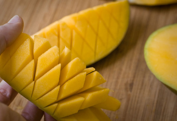 Chop chop how to cut a mango this is called the hedgehog cut my cut is a little abstract and less of a formal cube but you get the idea my initial cut was too diagonal ccuart Gallery